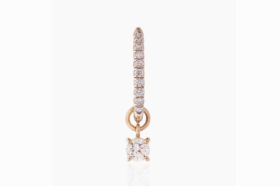 Otiumberg Diamond Charm Hoop earring in 9K yellow gold with .15 carats diamond, $730, otiumberg.com