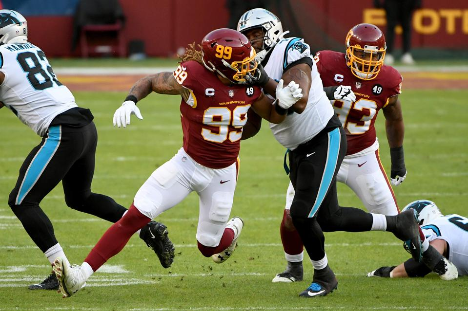 LANDOVER, MARYLAND - DECEMBER 27: Chase Young #99 of the Washington Football Team rushes the passer against Trent Scott #73 of the Carolina Panthers during the game at FedExField on December 27, 2020 in Landover, Maryland. (Photo by Will Newton/Getty Images)