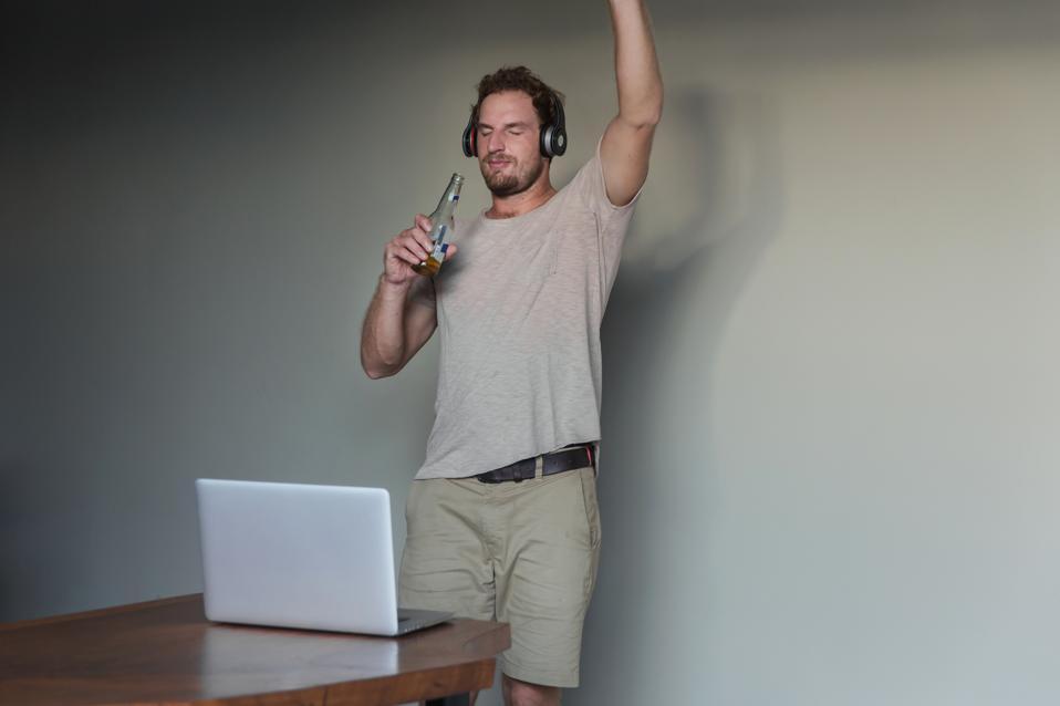 Single man enjoy virtual party at home