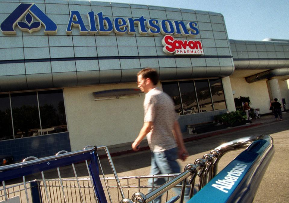 Customer makes his way to an Albertsons market in the the Los Feliz area.