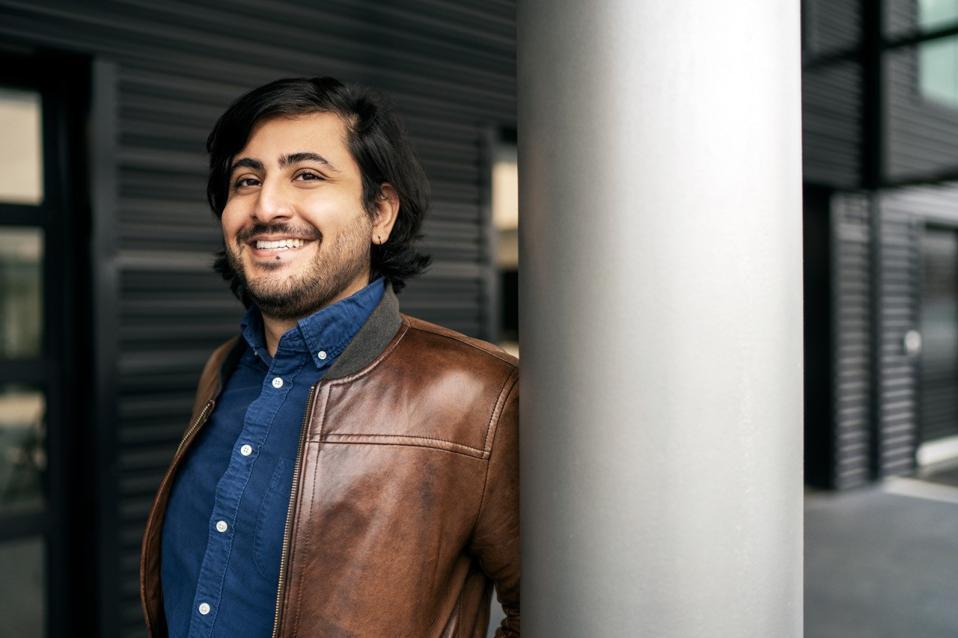 Zayd Enam, 29, cofounder, Cresta, smiling