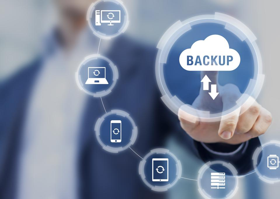 Backup files and data on internet with cloud storage technology that sync all online devices and computers with network connection, protection against loss, business person touch screen icon concept