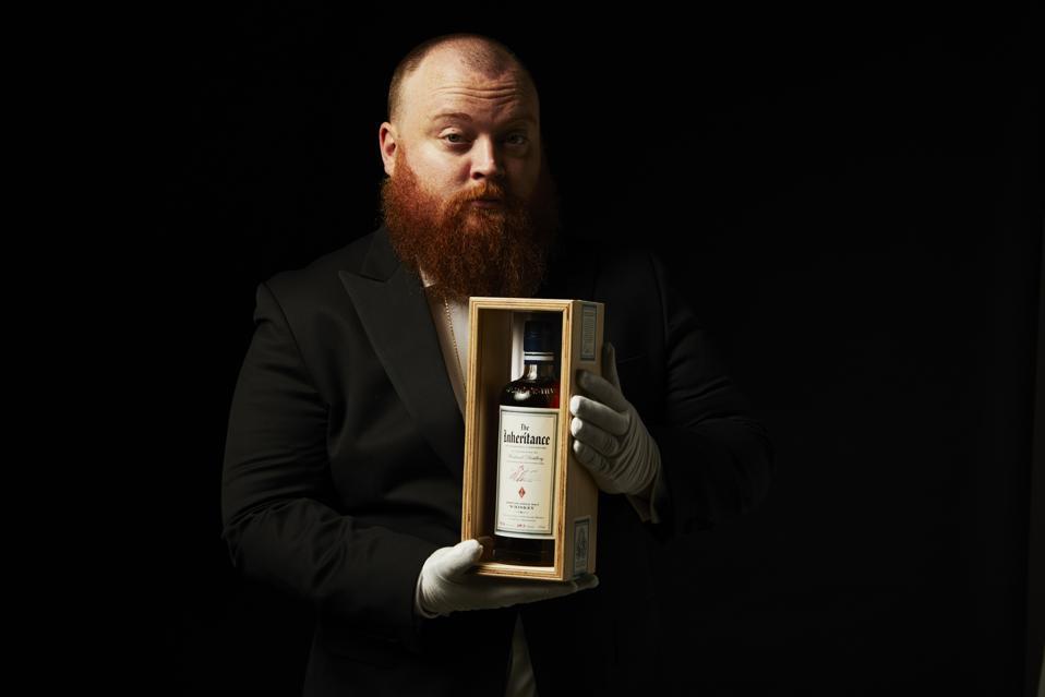 Westland Whiskey's Mat Hofmann holding bottle of The Inheritance American Single Malt Whiskey