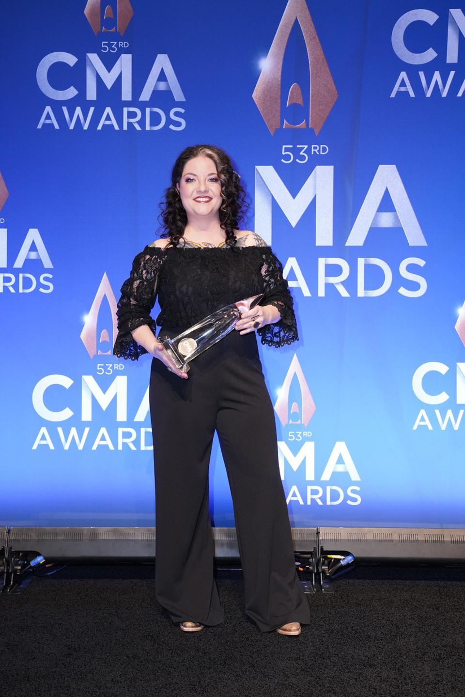Ashley McBryde accepts her 2019 CMA New Artist of the Year trophy in Ariat boots.