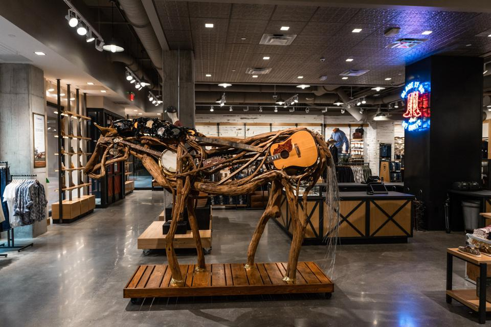 A life-size sculpture of a horse made of musical instruments is on display at Ariat.