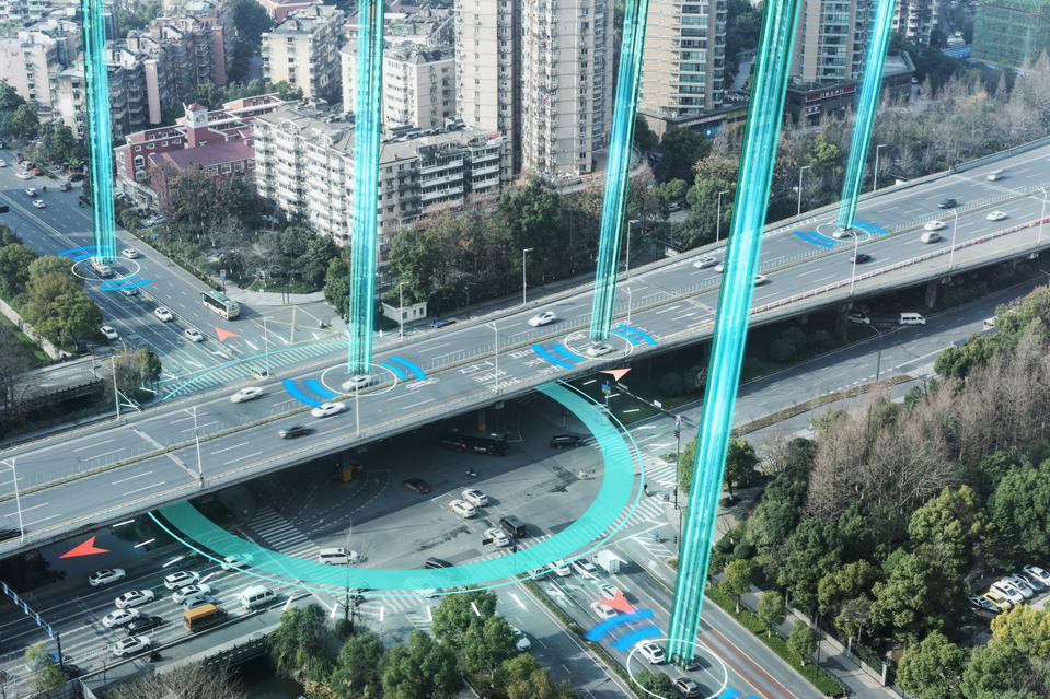 Smart infrastructure. Connected cars on highway. Internet of Things concept.