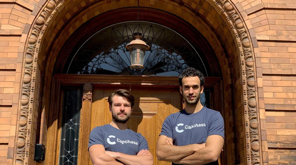 Przemek Gotfryd and Miguel Fernández with arms crossed in front of door
