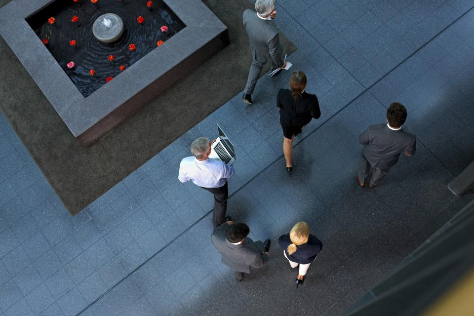 Top view of businesspeople walking through lobby