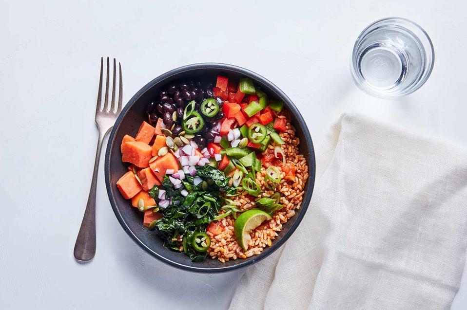 Overhead shot of vegetarian brown rice taco bowl from Splendid Spoon.