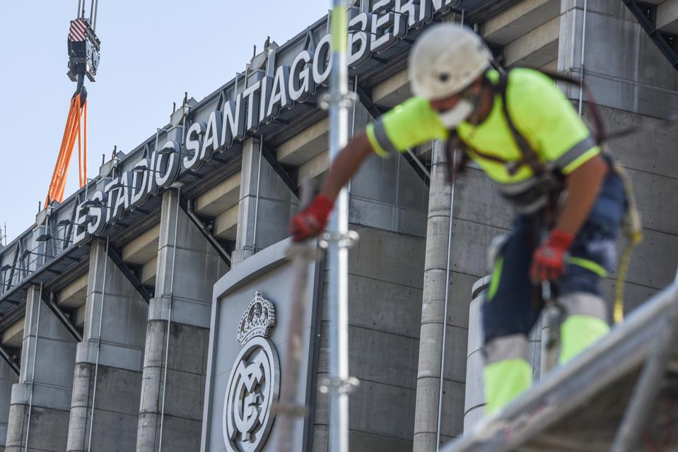 A worker doing renovation at the stadium. The new Bernabeu...