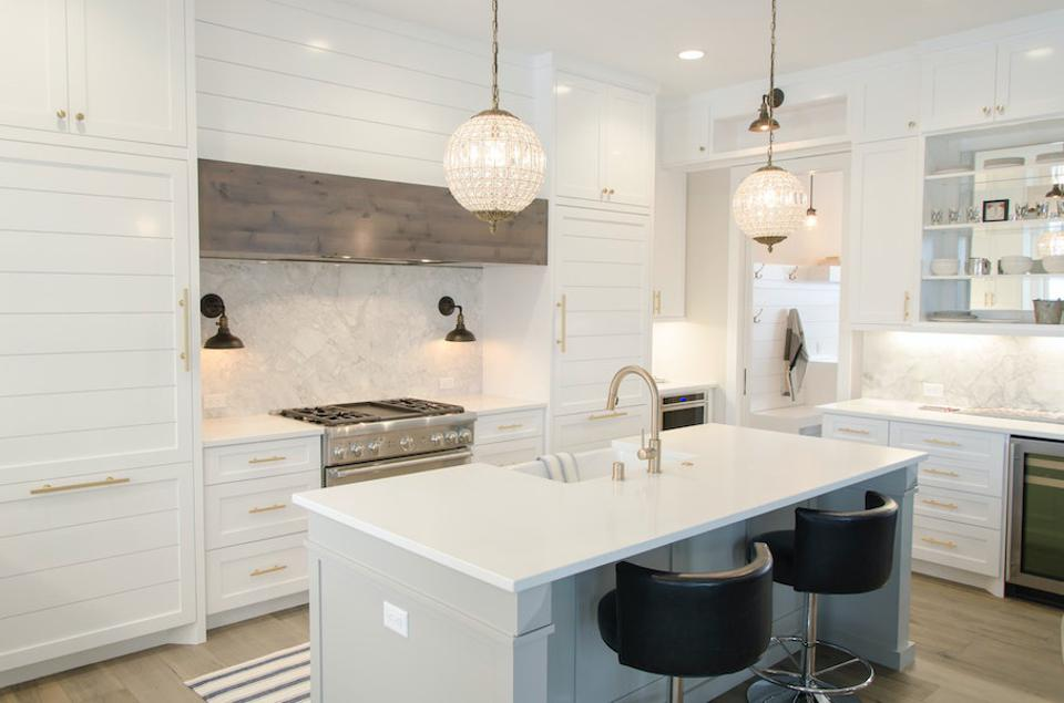 A kitchen with mixed metal finishes