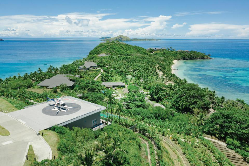 A helicopter site on a helipad on Kokomo Private Island.