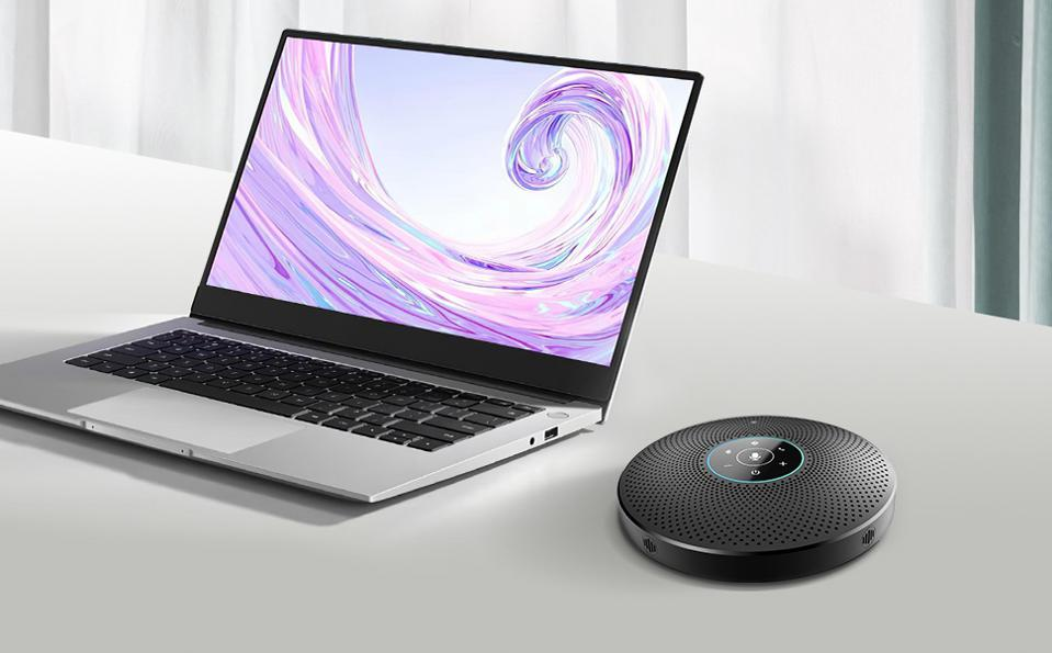 eMeet OfficeCore M2 Max speakerphone next to a laptop