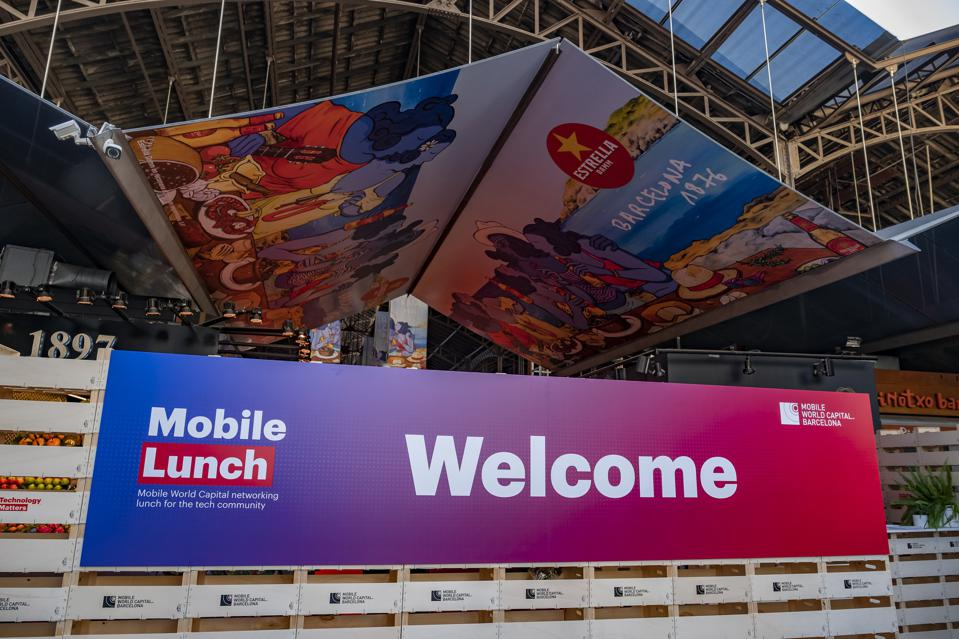 The Mobile Networking Lunch logo is seen at the main...