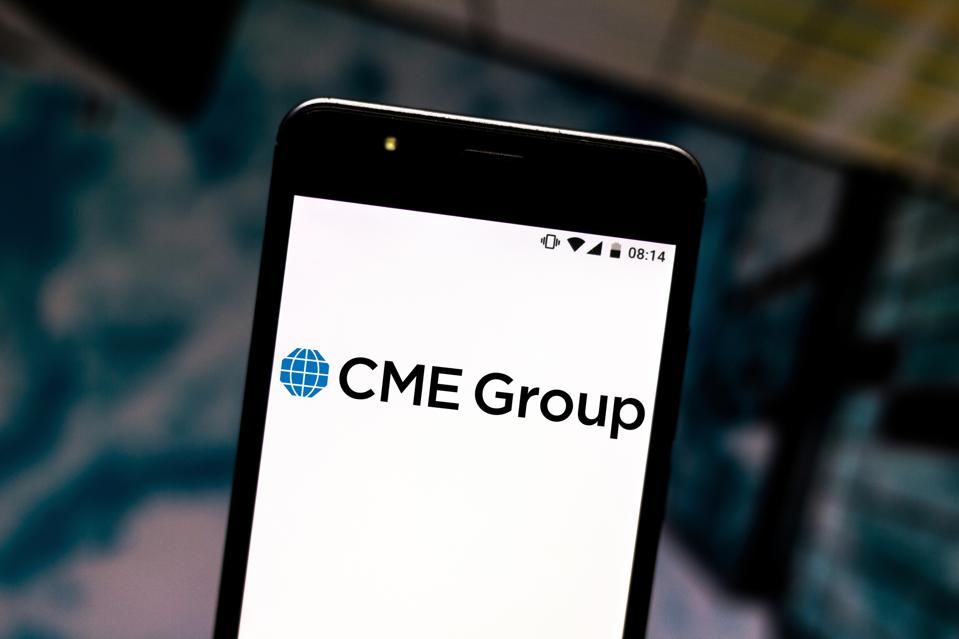 In this photo illustration a CME Group logo seen displayed...