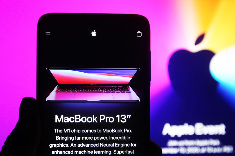 In this photo illustration the new MacBook Pro 13″ computer...