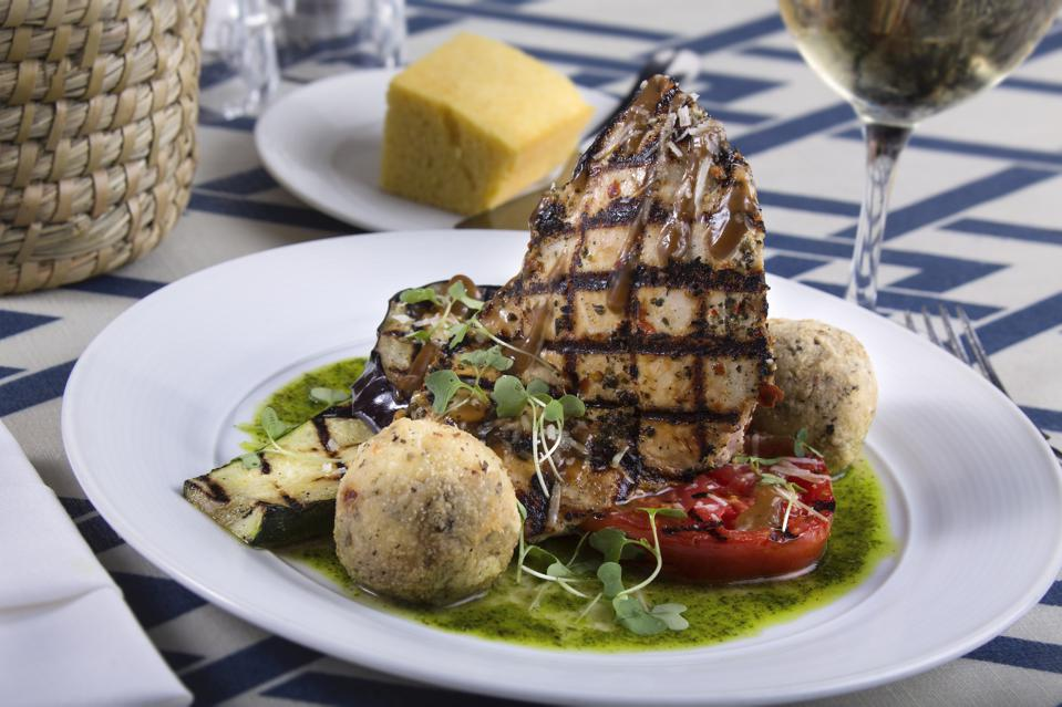 grilled chicken dish on blue and white table cloth