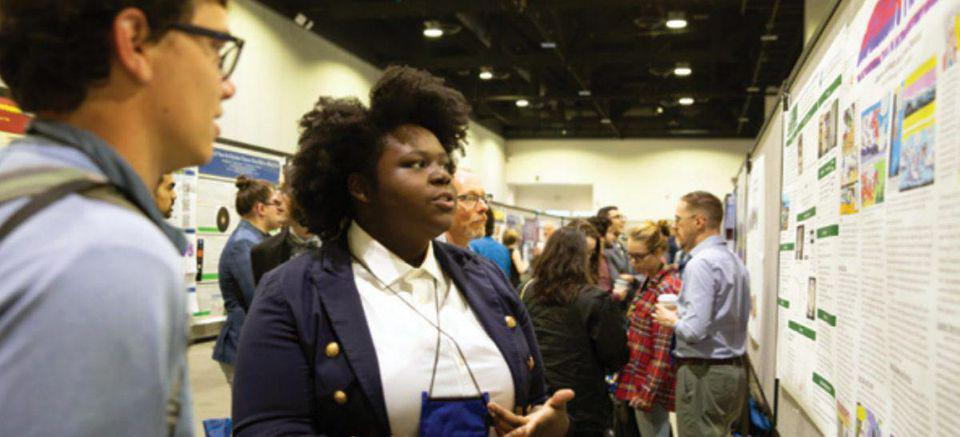 Underrepresented minority student at a professional academic conference.