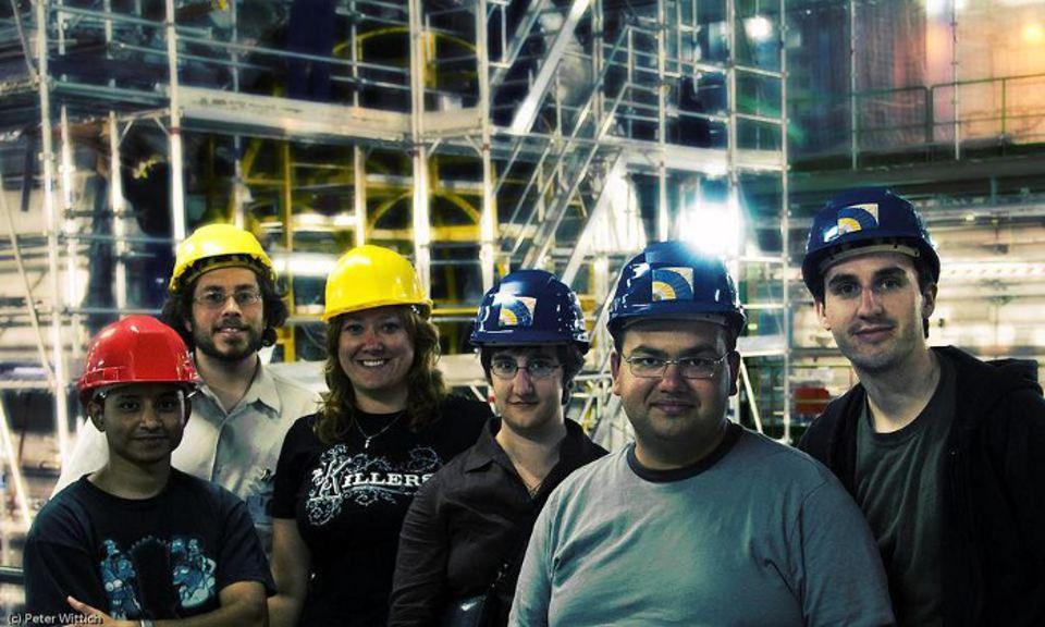Cornell graduate students and postdoc in 2007, at the LHC's CMS detector.