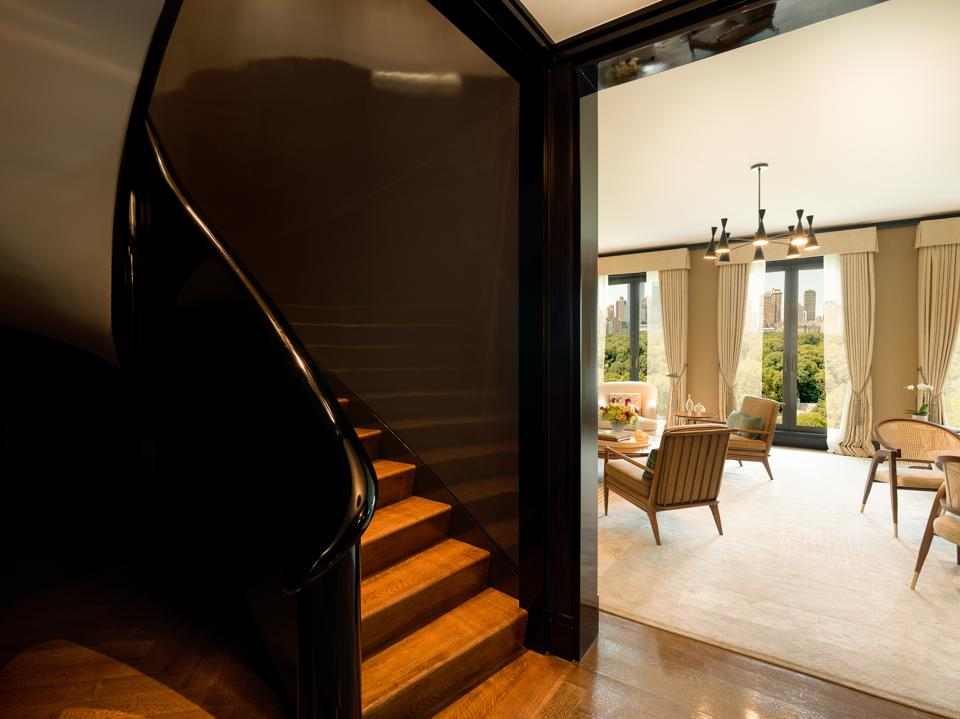 The oval staircase leading to the Master Suite floor in a duplex residence.