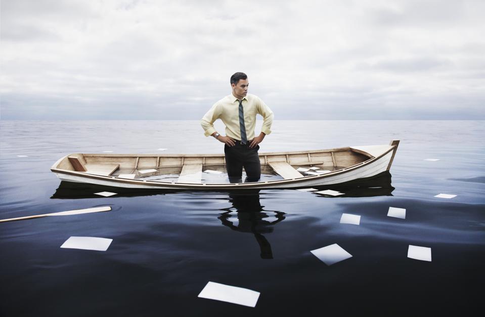 businessman in a sinking boat