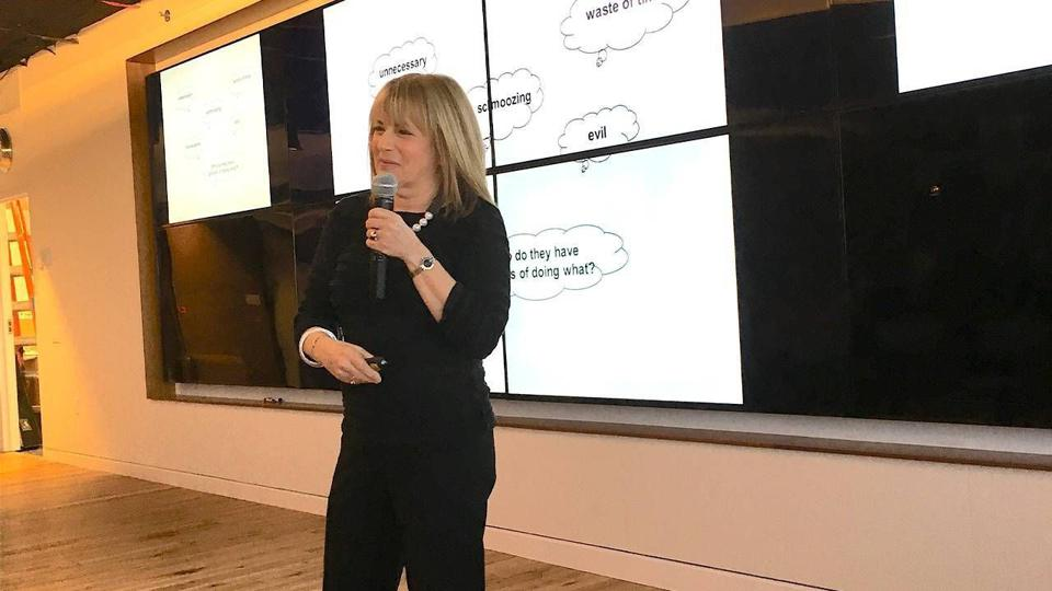 Author Bonnie Marcus speaking at an event