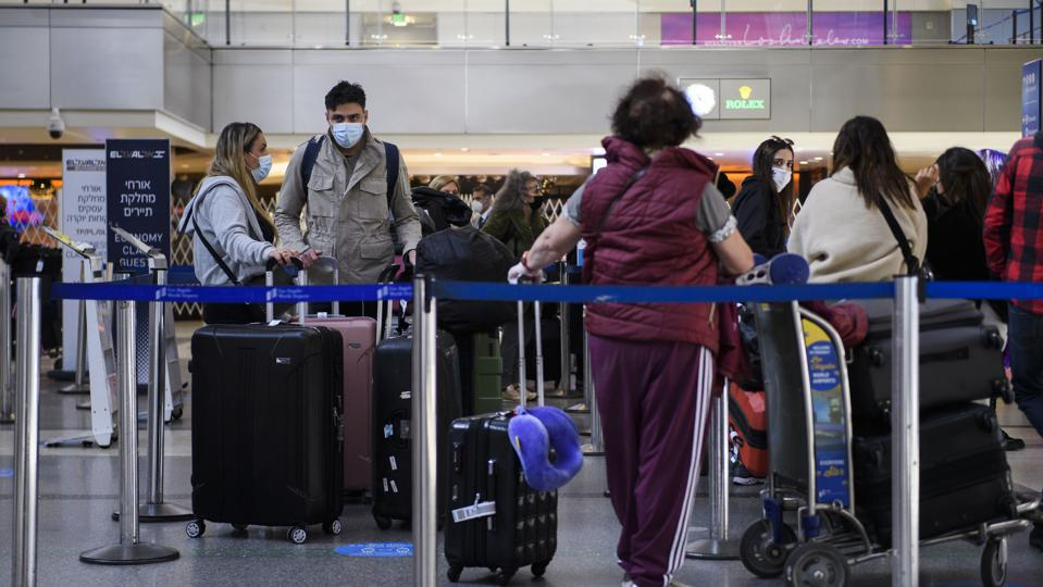 Can You Travel If You're Fully Vaccinated? CDC Says Yes...But Don't.