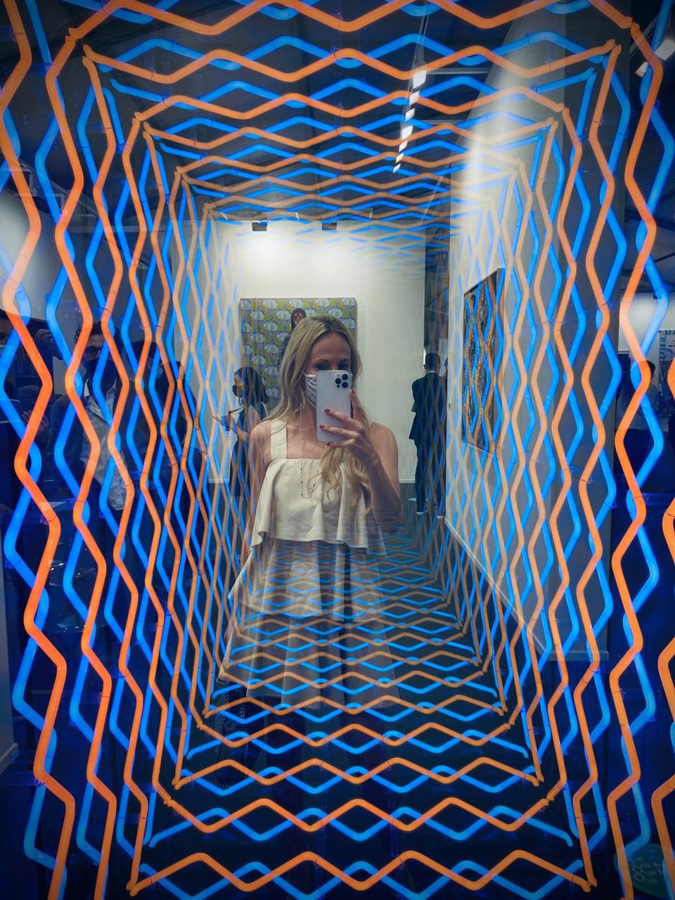 Nel-Olivia Waga mirrored in Ivàn Navarro's artwork ″Clown 2021″- Templon Gallery at Art Dubai 2021