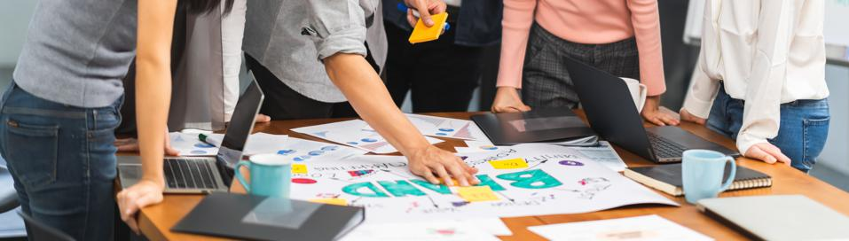 Young Asian creative team work together in brainstorm meeting, Business brand design project. Modern office, colleague coworker, marketing advertisement research, or productivity teamwork concept