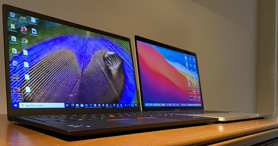 Lenovo ThinkPad X1 Nano (left) and M1 MacBook Pro.