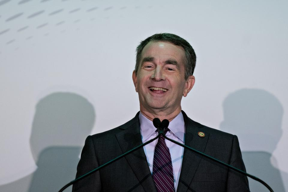 Ralph Northam, governor of Virginia, smiles while speaking during a news conference in Arlington, Virginia.