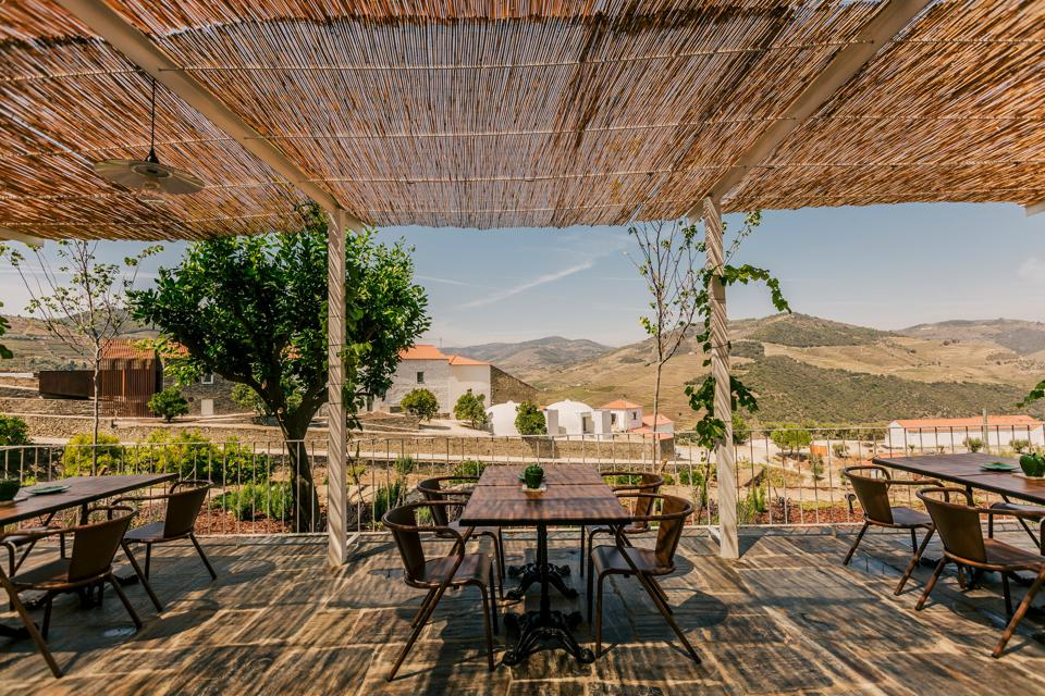 The terrace at Ventozelo Hotel & Quinta in Portugal looks over the Douro Valley