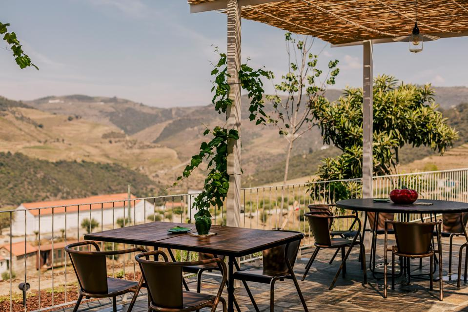 The tables on the terrace at Ventozelo Hotel & Quinta in Douro, Portugal, are far apart