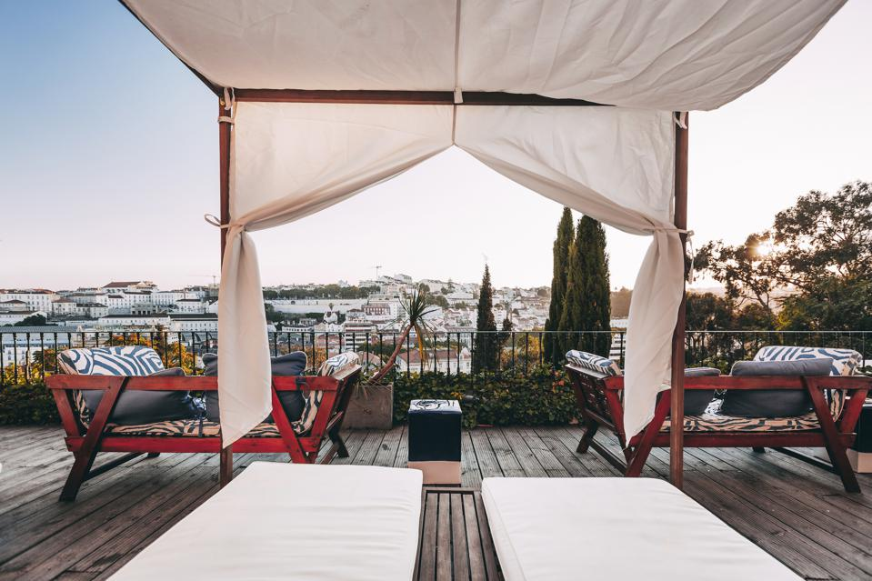 The terrace at the Torel Palace in Lisbon, Portugal, has a view over the city's rooftops