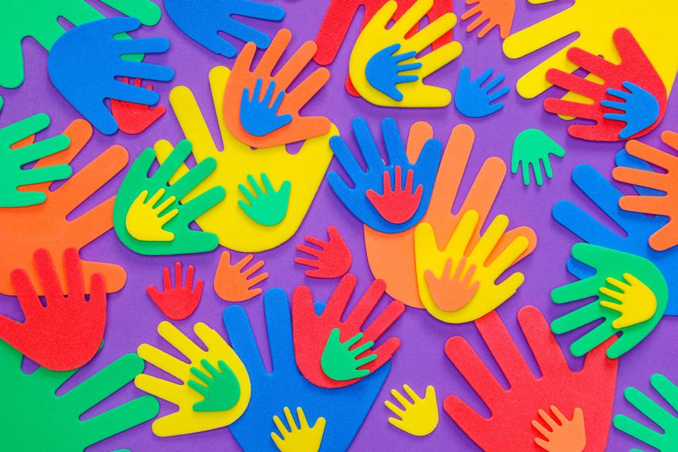 Brightly colored foam hand shapes showing importance of bonding through hard times.