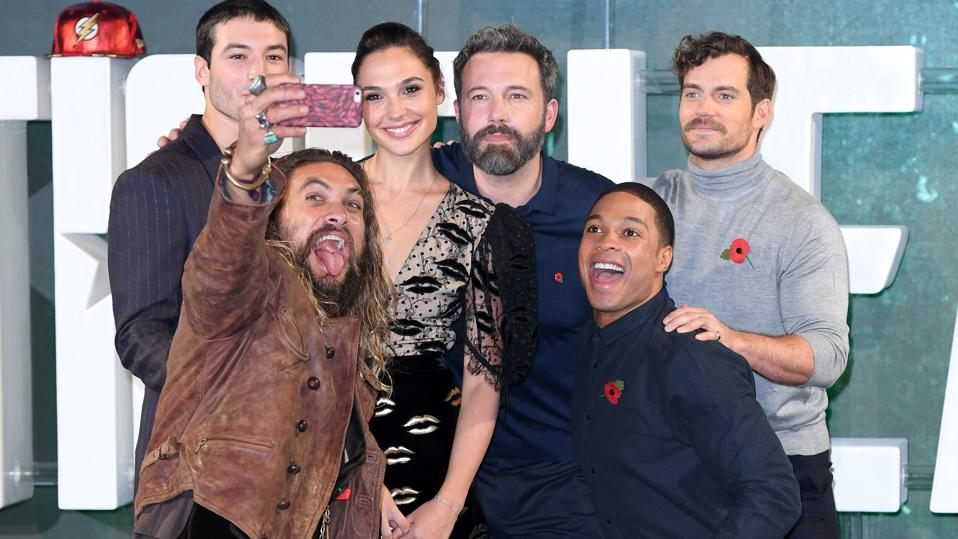 The Justice League cast pose for a photo.