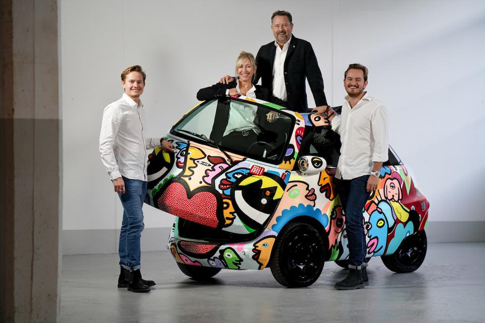 The Ouboter family, founders of Micro, with a Microlino prototype