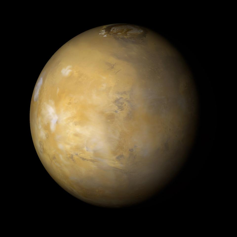 It is northern summer on Mars and clouds are very common over the famous Tharsis volcanoes during the afternoon. Mars Global Surveyor Orbiter.