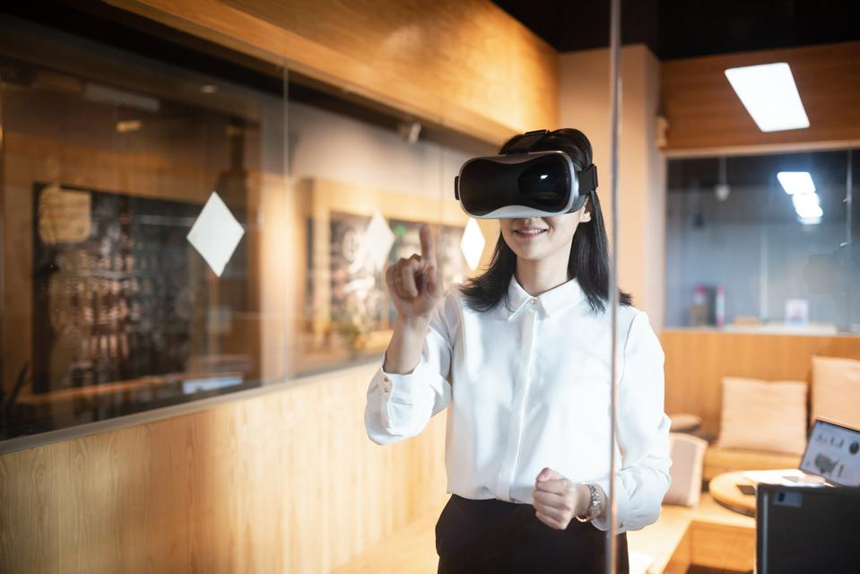 businesswoman working with virtual reality in office