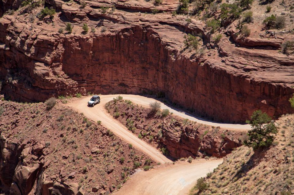 Shafer Trail Road switch-backs and traffic make this dirt road in Canyonland National Park very exciting to drive