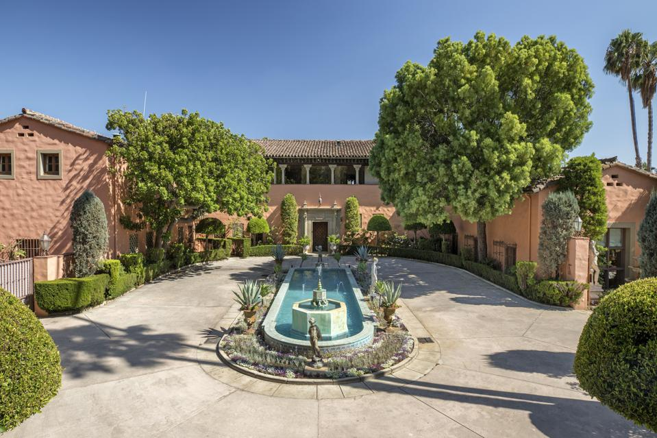 entrance to william randolph hearst's estate in beverly hills