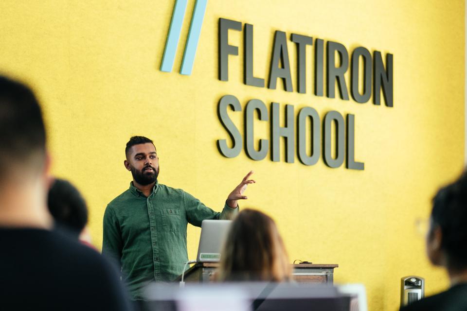 An instructor teaches a class at Flatiron School in New York City.