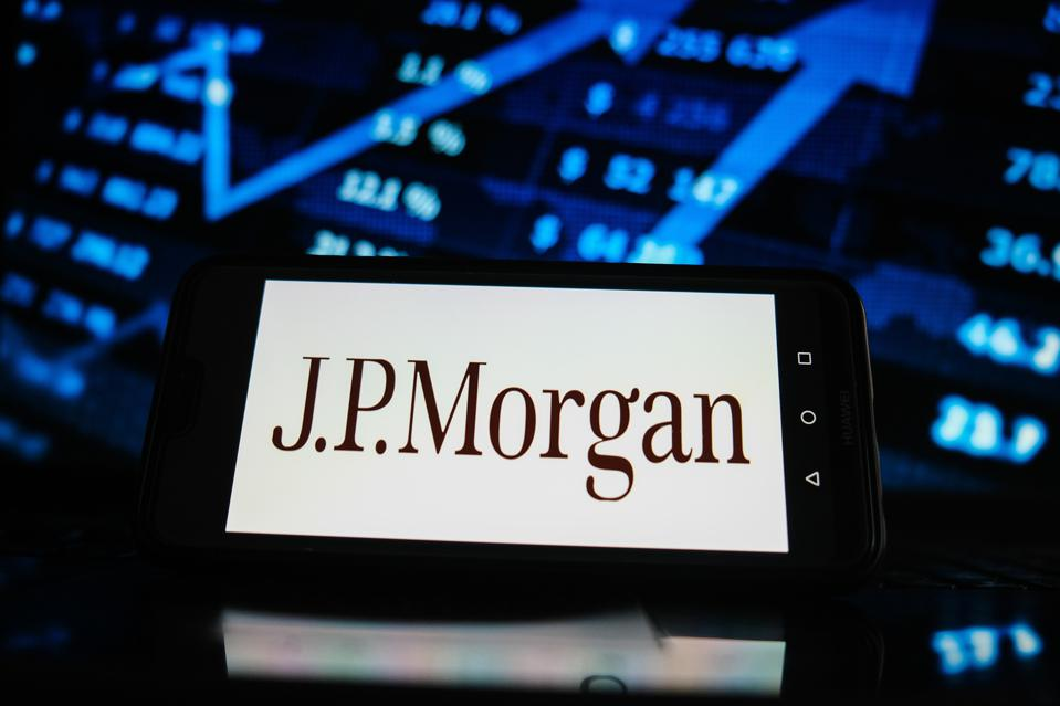 In this photo illustration a JP Morgan logo seen displayed...