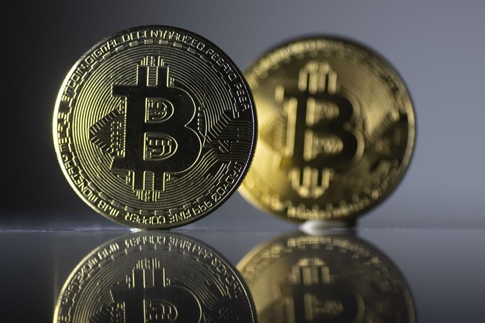 In this photo illustration the Bitcoin cryptocurrency...