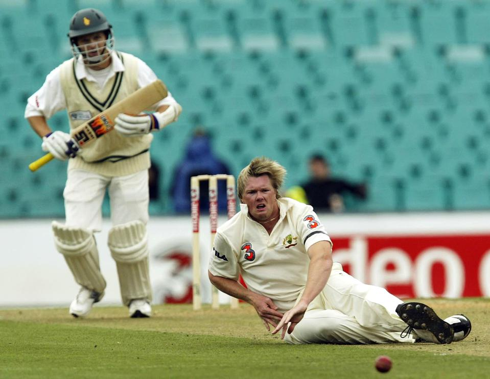 Brad Williams of Australia dives after a drive from Mark Vermeulen of Zimbabwe