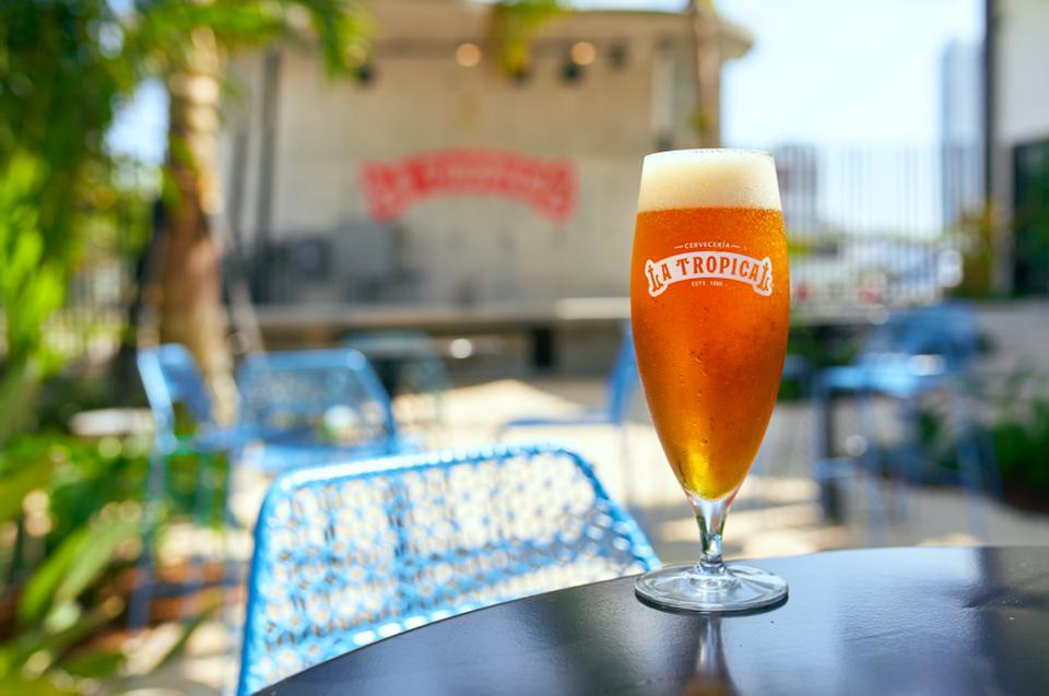 a cold beer in a tropical setting at Miami's Cervecería La Tropical in Wynwood