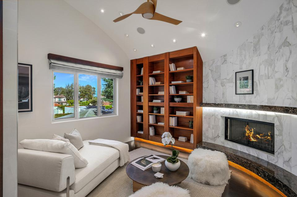 The master bedroom has a lounge area and also a safe   room located behind the bookcase.