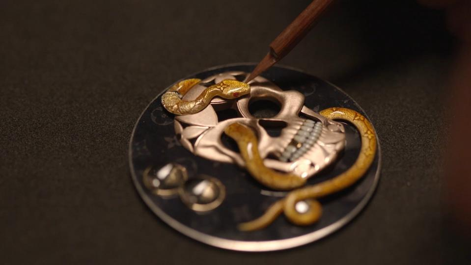 Over 50 hours of work were required to enamel the snake and dial of the Louis Vuitton Tambour Carpe Diem.
