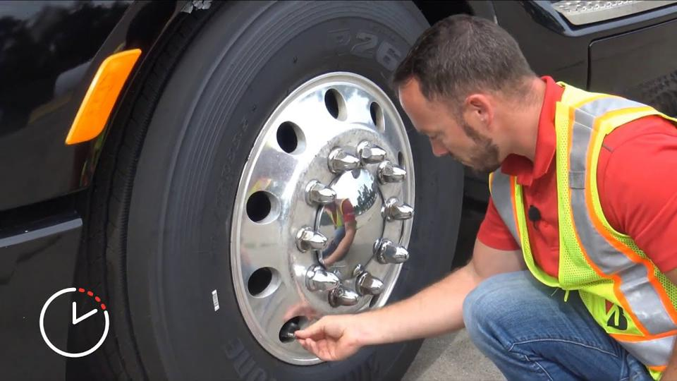 Technician monitors tire conditions on a commercial vehicle.