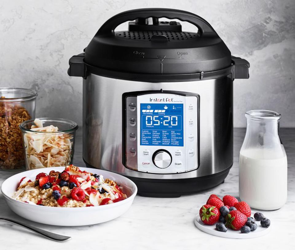 Instant Pot Duo Evo Plus set up next to a bowl of fresh yogurt and toppings.
